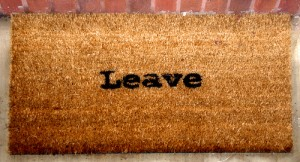"welcome mat that says ""leave"""