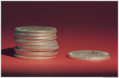 stack of nine coins and one coin