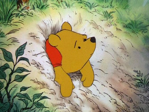 Winnie-the-Pooh can't get out of Rabbit's hole. Aww.