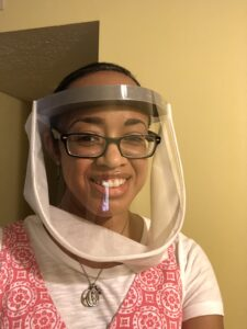 Me, wearing the intense face shield I'm allowed to use at school